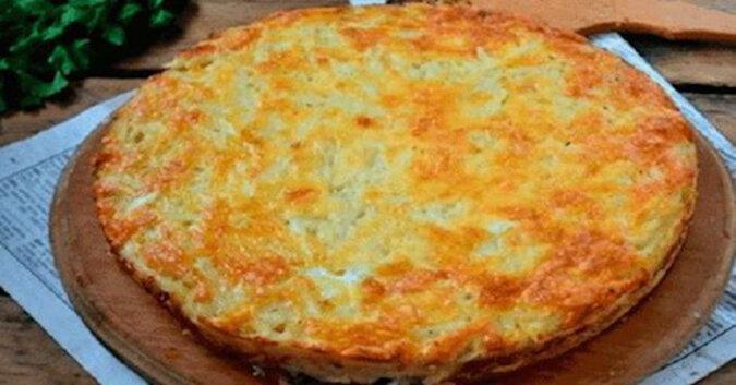 Zapiekanka z tartych ziemniaków z serem i czosnkiem. Pikantne i bardzo oryginalne danie